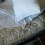 Old mattress protector tied together
