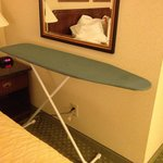 Ironing board not put away & a glimpse of improperly made bed upon entering room for the first t