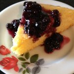 delicious corncake with blueberry sauce