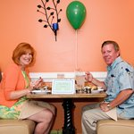 A sweet couple celebrating a birthday in our intimate Clementine Room