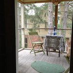 The screened in porch off of the room - great place for a glass of wine, and gives nice ventilat