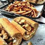 Vegan: Chicken Cheesesteak with Soy Cheese, Grilled Peppers & Onions with a side of French Fries