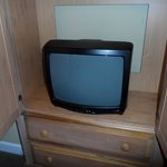 master bedroom TV, no flatscreens anywhere, look at the condition of the armoire