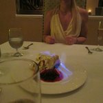 Amazing dessert Baked Alaska with rum which was set alight