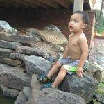 My grandson enjoying the waterfall.