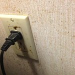 Dirty wall and electrical outlet