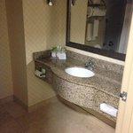 Nice modern vanity. Spacious bathroom.