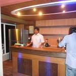 Mr. Naseer behind the bar at the restaurant on the roof
