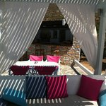 lovely squishy cushions in a tented area pool side
