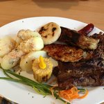 Parrillada Caribe - meat platter with corn/cheese pattie, corn on the cob  and potatoes