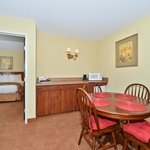 Enjoy a little extra room in our Suites featuring a living/dining area and separate King bedroom