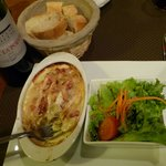 Tartiflette, a signature French dish of the Haute Savoie region served with salad and fresh brea