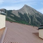 Viiew of the Crested Butte peak over the roof of a neighobhoring building.