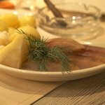 Boiled potatoes with cured fish