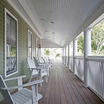 Relax in a rocking chair on The Nantucket's front porch. (70094723)