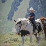 """My 5 year old on his gentle horse """"Dollar"""".  Notice the amazing view!"""