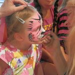Face painting: pink cat w/ roses