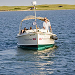 Take our complimentary, spectacular water taxi from Edgartown to The Dunes, in-season.