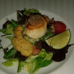 Seared fresh king scallops, black truffles and oyster beignets