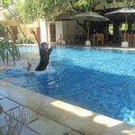 my son enjoying the pool