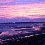 Breathtaking beach sunset at Dawson's Seaside Getaway