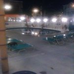 the view of the pool area at night