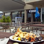 Seafood and local wine to enjoy in our outdoor dining area overlooking Boston Bay