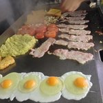 a full english breakfast being cooked