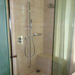 huge shower complete with seat