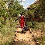 Masai man helping us with a luggage