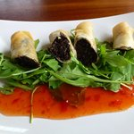 Starter: Haggis & Black Pudding Spring Rolls on Rocket with a Chili Sauce
