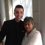 Javi Titos, the receptionist, and me. he rescued me out of two jambs.