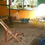 Middle area of the hostel with tables and hammocks