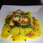 Grilled swordfish fish on spinach and rice