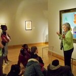 Tour guide discusses an original painting by Pablo Picasso