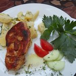 tastiest chicken with potatoes. And decoration - celery tops with a yellow flower...