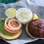 Freshly made crab cake sandwich with cole slaw.