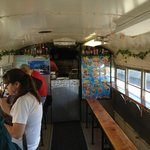 bench seating and ordering inside the Taco Bus