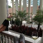 Relaxing on the poarch at Moana Surfrider