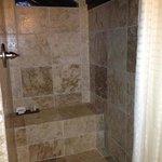 Roomy stone shower.