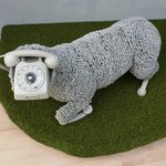 A sheep made from phones and phone-cables
