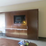 Flat screen TV and coffee hutch
