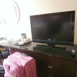 Nice long desk / dresser with electrical outlets built in.