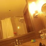 nice lighted makeup / vanity mirror, moon shower rod for more room