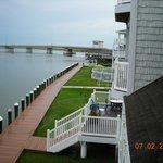 view off balcony of grounds near outdoor pook & causeway to mainland