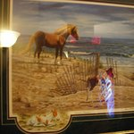 Chincoteague Pony prints displayed on walls throughout hotel