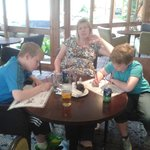 Mum and boys doing puzzles