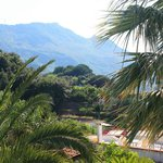 Hotel Grifo - View of mountains from raised sunbathing deck by pool