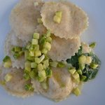 Buckwheat raviolis filled with ricotta and fish-eggs (bottarga), zucchini with butter and sage