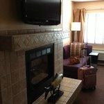 Gas Fireplace, Large Flat Screen TV And Sofa.